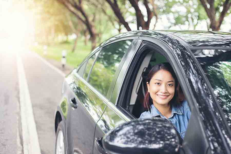 lady leaning out of rented car
