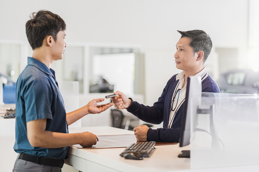 Man receiving car keys from company offering car rental in Singapore