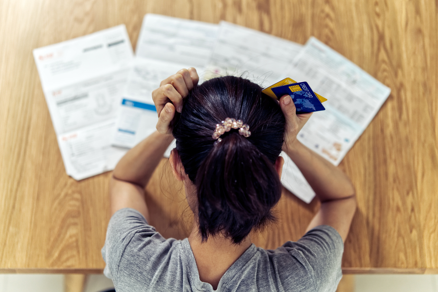 Woman experiencing stress over cost of car ownership in Singapore